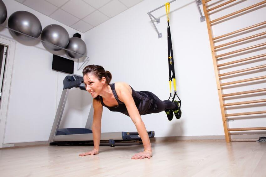 Woman Doing Push Ups with Resistance Bands