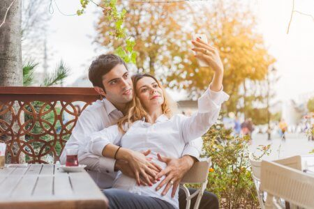 Young couple waiting for a baby, takes a Selfie in a bar in front of the Blue Mosque in Istanbul.