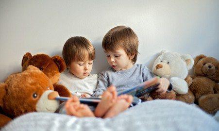 siblings reading bedtime stories