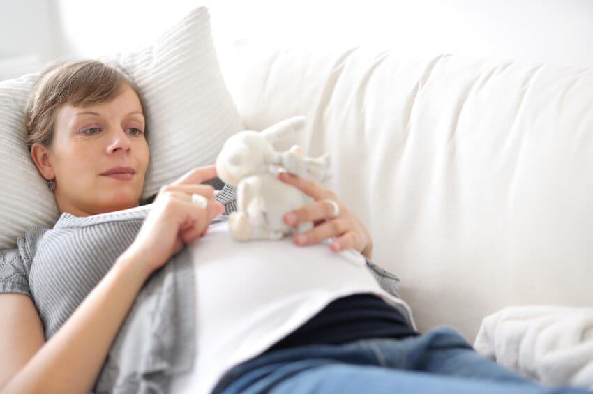 Pregnant lady with stuffed toy