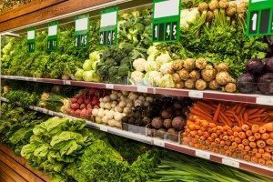 shelves of vegetables in a supermarket