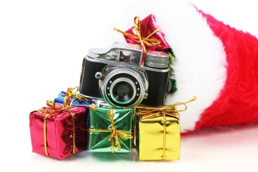 camera sitting on some boxed gifts