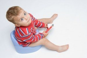 Potty training can become easier if older siblings get involved.