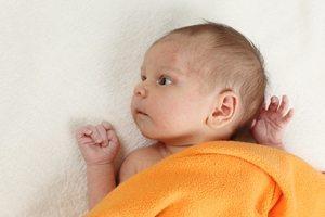 baby under a blanket