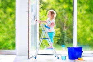 toddler washing windows