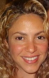 celebrity shakira smiles and looks into the camera