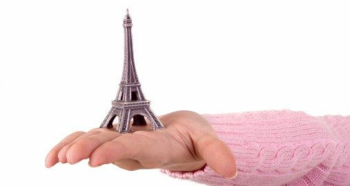 baby holding eiffel tower model