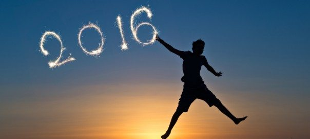 2016 written with sparkles, silhouette of a boy jumping in the sun