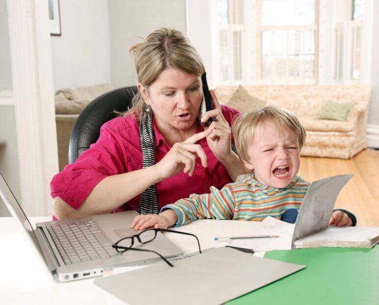 mom struggling to get work done with toddler nearby