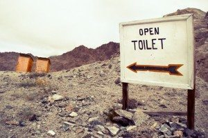 "picture of an outdoor toilet with a sign that says ""open"""