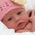 picture of newborn with pink knit hat