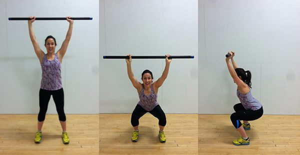 fitness woman performing an overhead squat