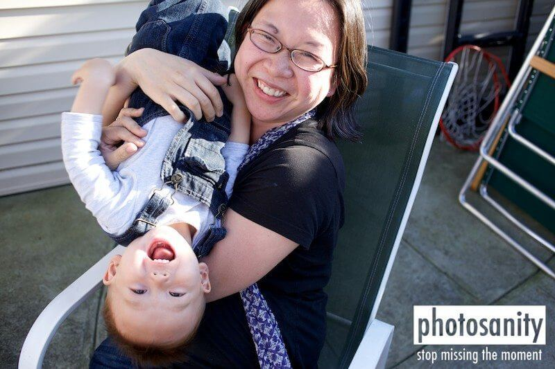mom holding child upside down