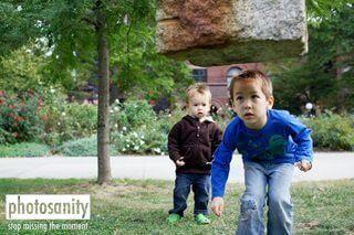 boy climbing under rock