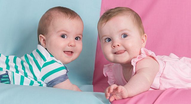boy and girl babies smiling