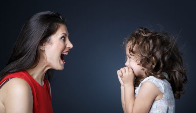 Mother playfully shouts to her daughter