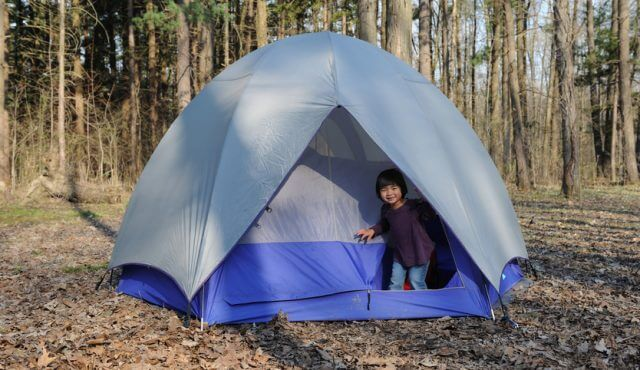 Young Girl in Camping Tent