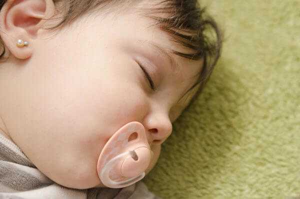 Pacifiers can help babies get more comfortable in their sleeping positions.