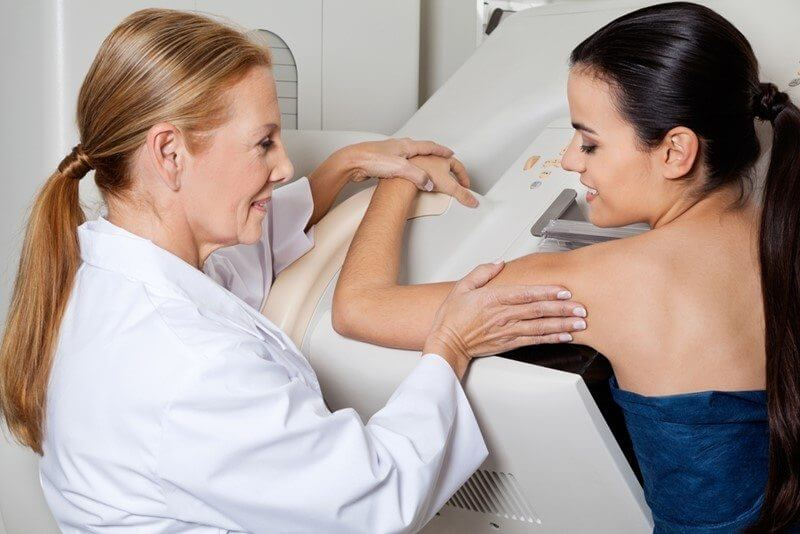 a woman having a mammogram