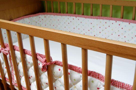 an empty baby crib