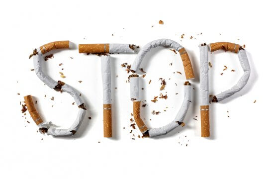 the word stop written in cigarettes