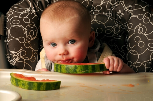 Babies should try foods one at a time to assess their reactions.
