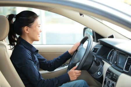 a mom driving a car