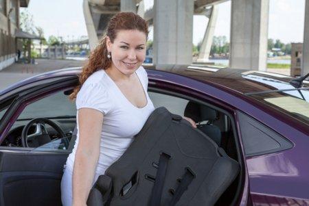 a mom installing a car seat