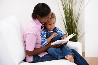 a mom reading with her son