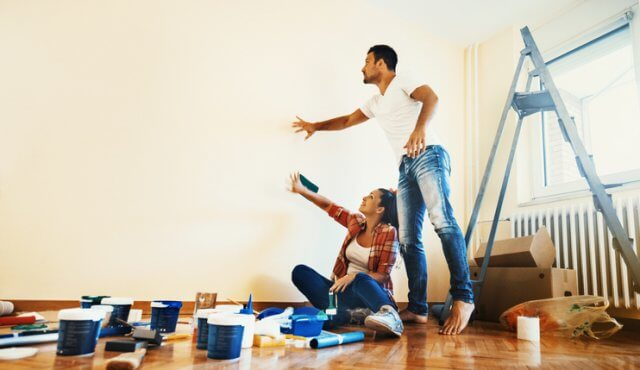 Closeup Of Early 30u0027s Couple Making Decisions About What Color Their Walls  Should Be. They