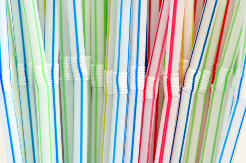 a pile of plastic drinking straws