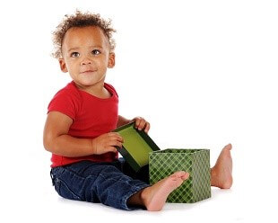 a baby sitting with an empty box