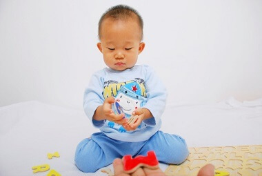 a young boy playing with a toy