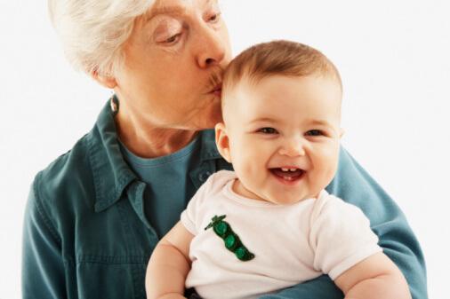 a grandma kssing her grandson