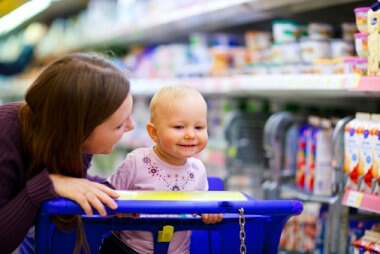 a mom and her baby in a supermarket