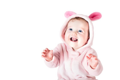 a baby dressed in a pink bunny outfit