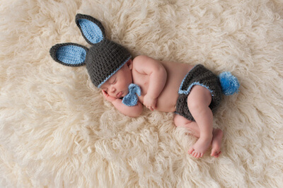 a baby dressed as a bunny