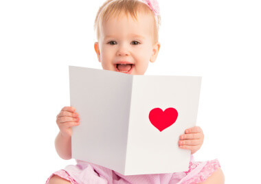 a baby holding a card