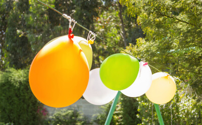 balloons hanging on a line