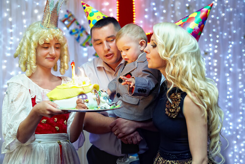 a family celebrating baby's first birthday
