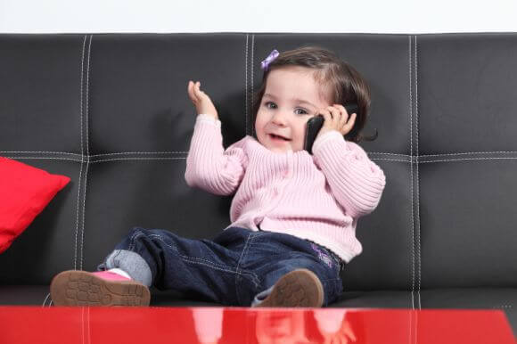 a baby talking on a phone