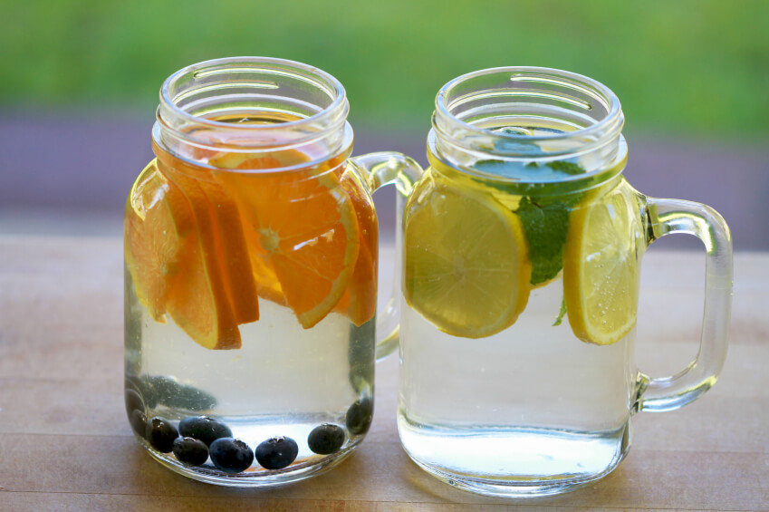 two large mason jars of fruit infused water