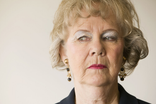 an angry looking older woman