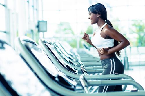 a woman running on a treadmill