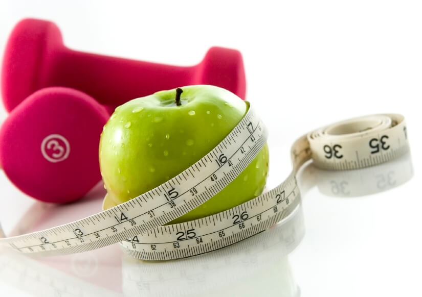an apple and some weights