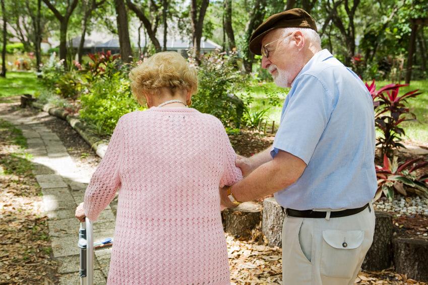 an elderly couple going for a walk
