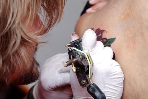 a woman getting a tattoo