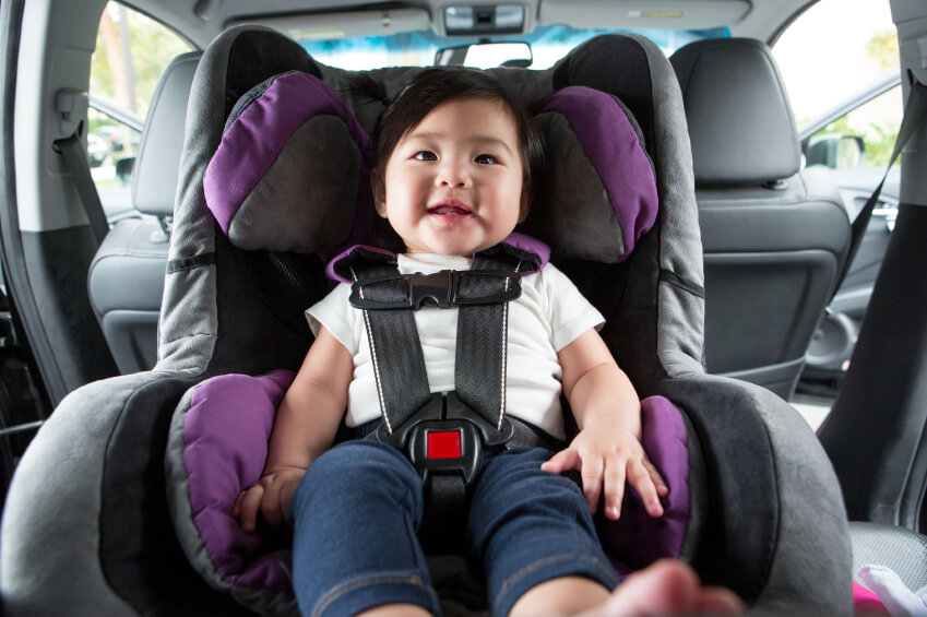 a baby sitting in a car seat