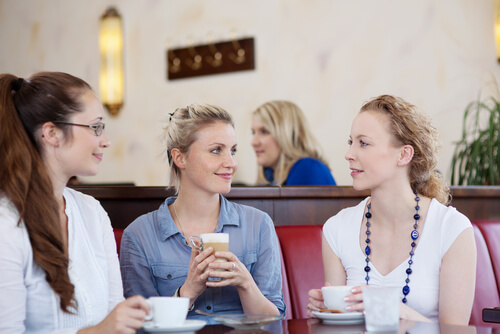 a group of female friends at a cafe