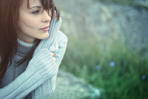 a woman outside in deep thought